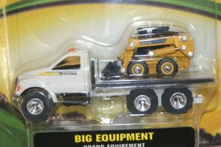 This is a Ertl John Deere Big Equipment Bob Cat on flat bed truck