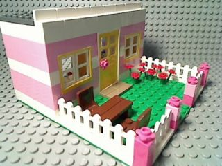 female house girl city bungalow flower rose garden white picket fence