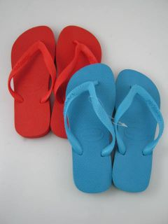 on a pair of lot 2 new havaianas kids red blue flip flops in a size 4